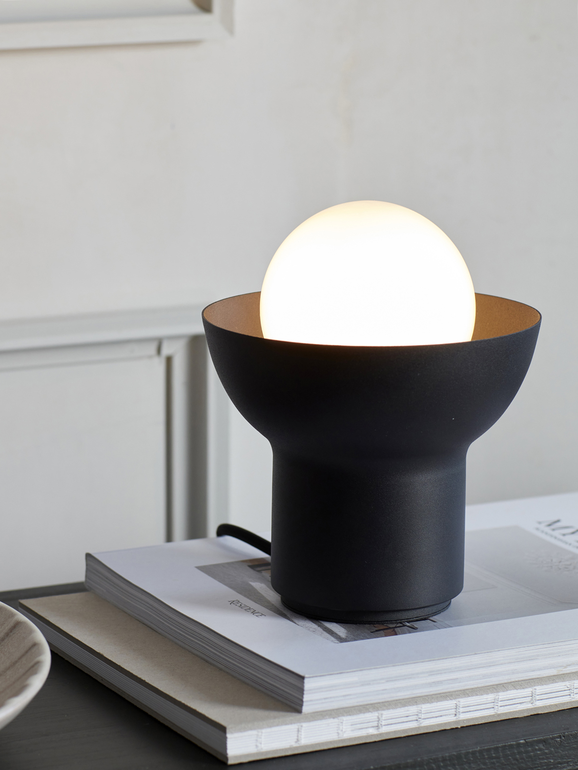 Black table lamp from Co Bankeryd designed by Odda